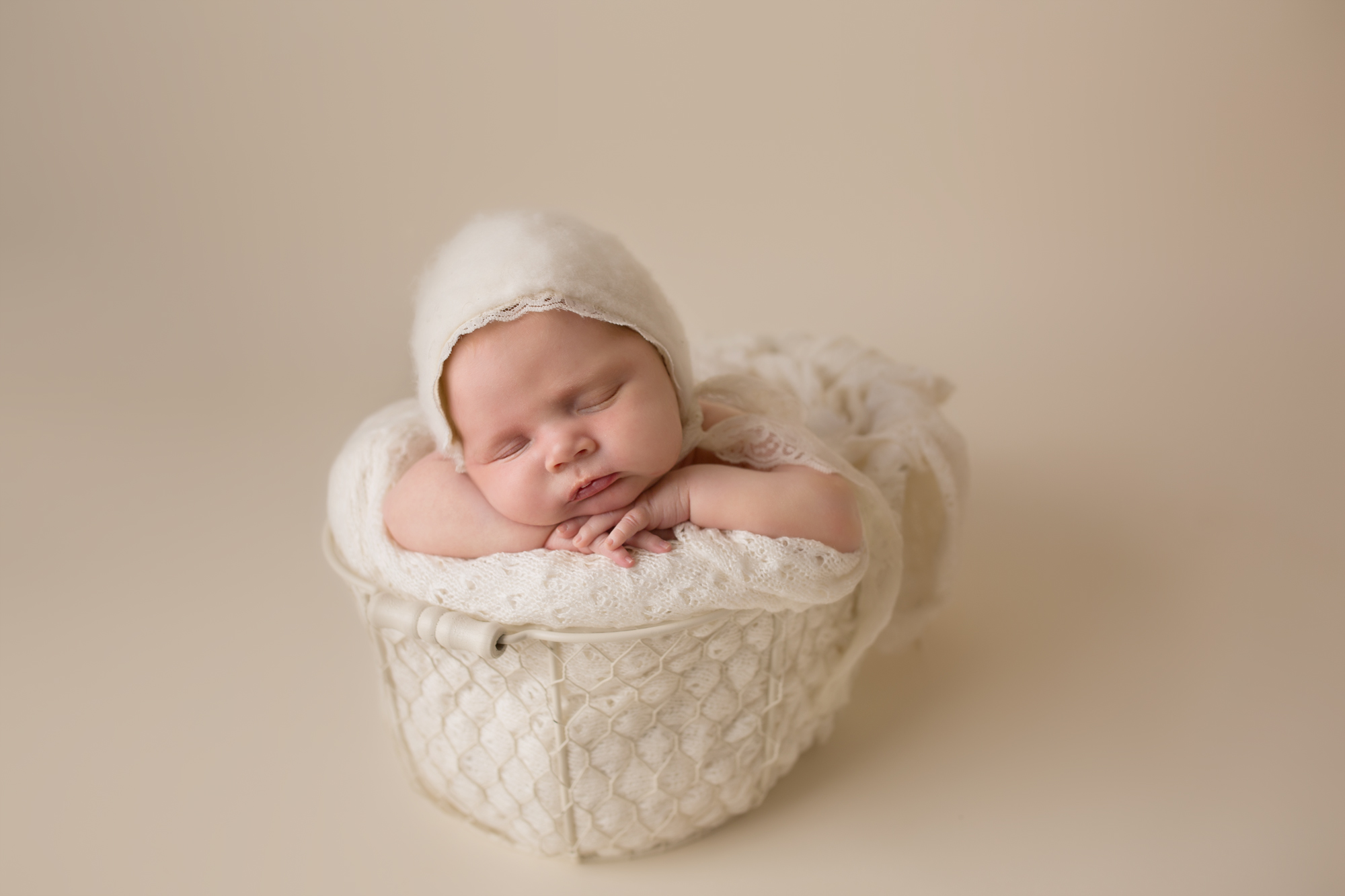 newborn baby girl cream studio