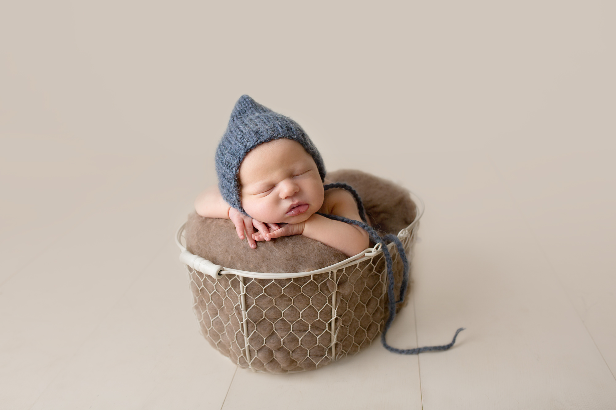 newborn baby boy cream brown studio
