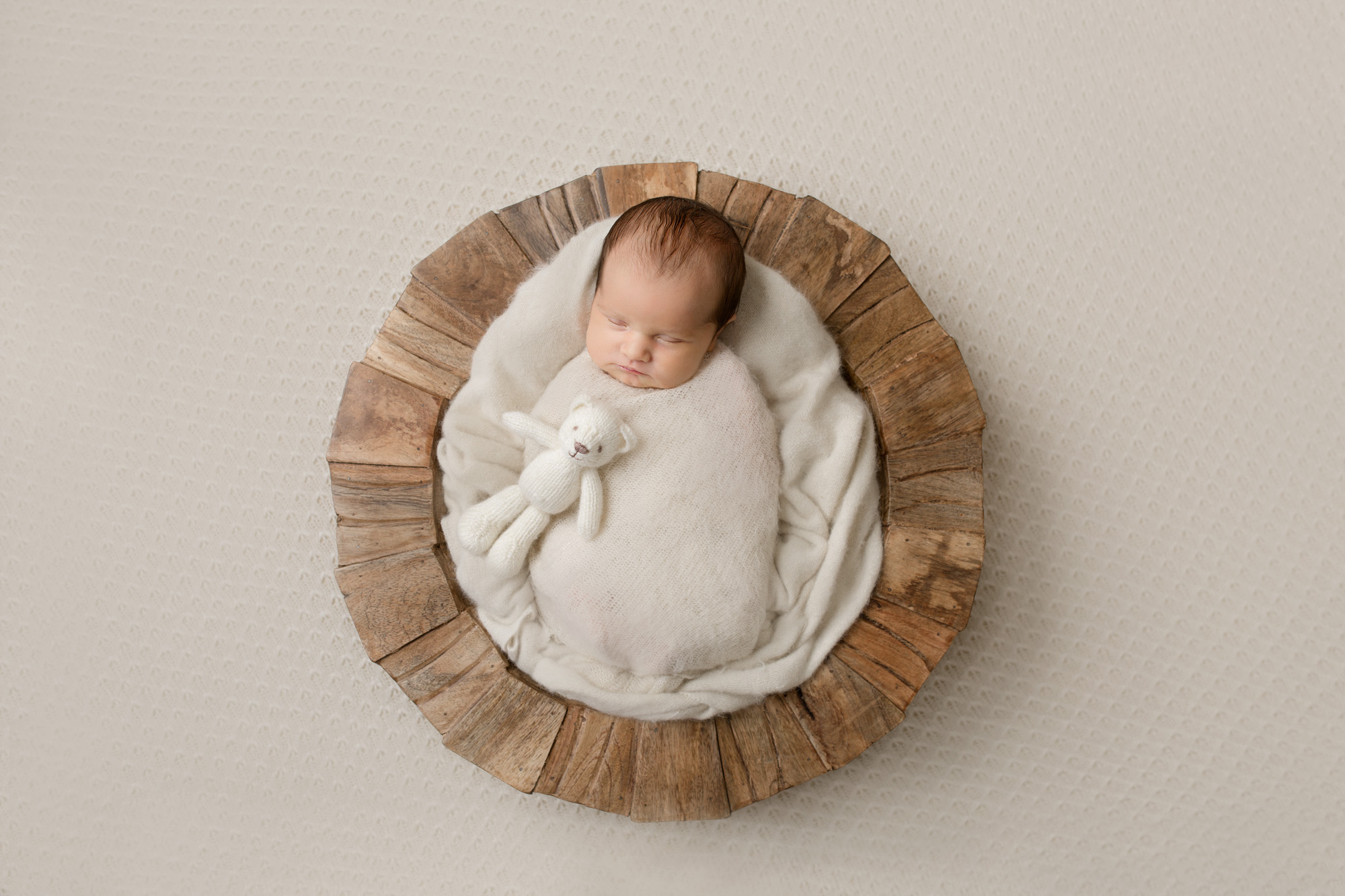 newborn baby girl in bowl
