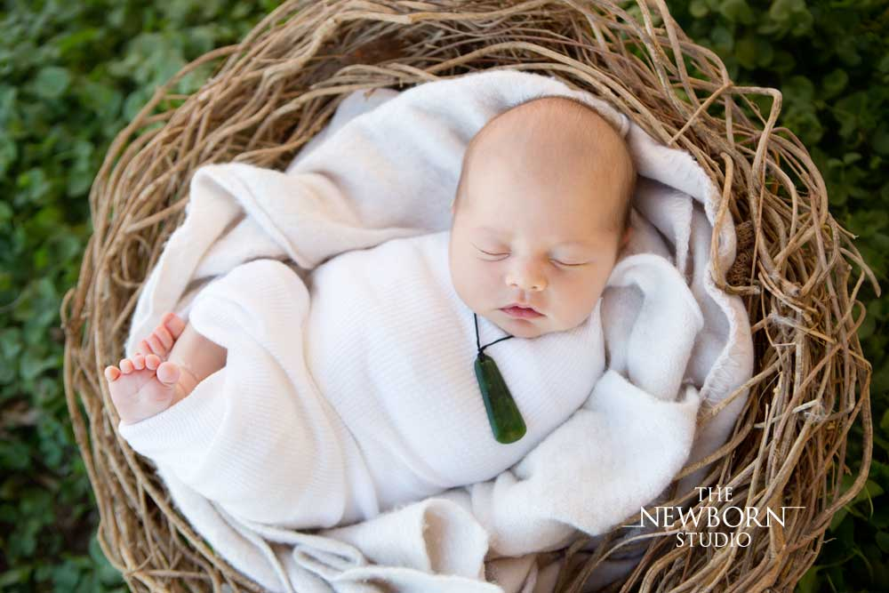 newborn baby photos taken outdoors