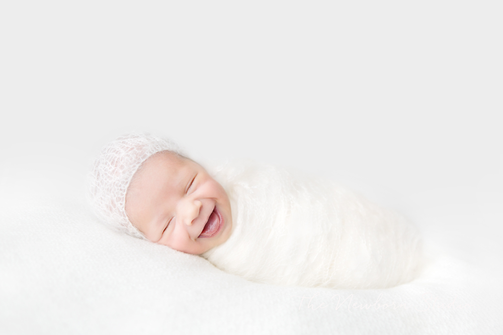 happy smiling newborn baby