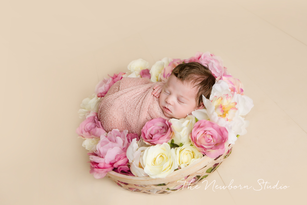 newborn baby girl flowers studio