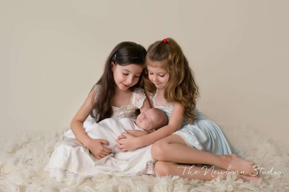 siblings sisters newborn boy studio