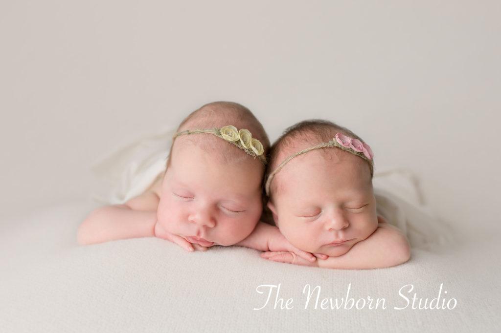 twin baby girls on beanbag studio light newborn twins
