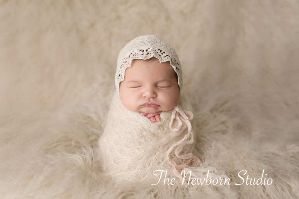 baby girl wrapped newborn studio