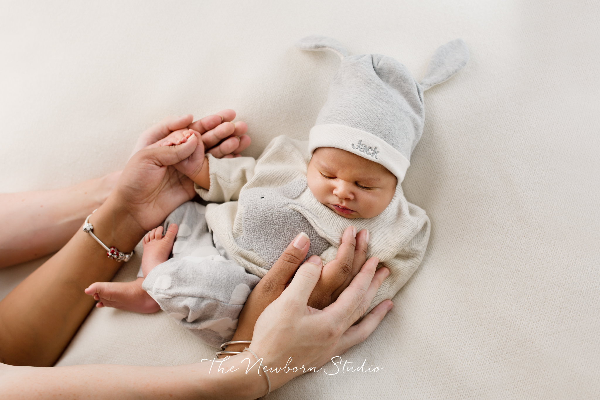 baby boy dressed in parents hands