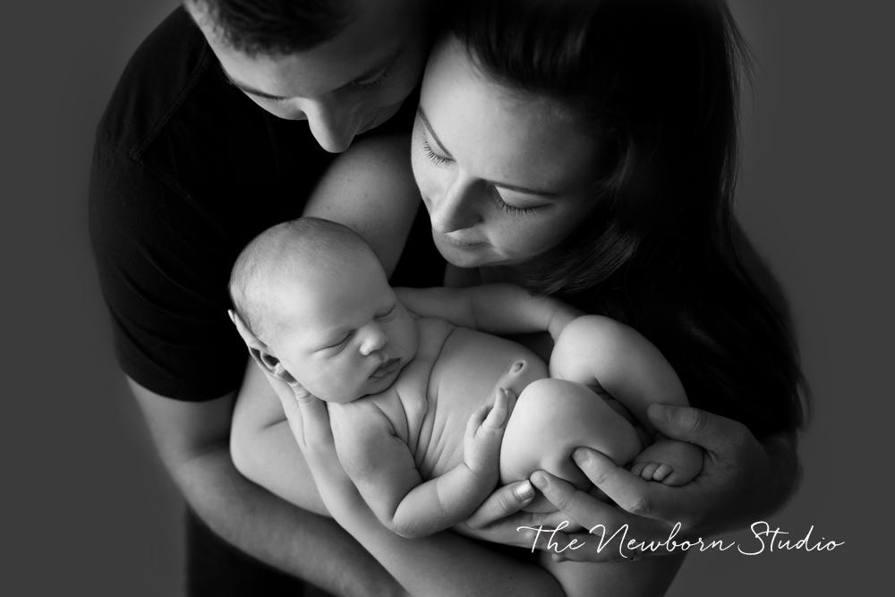 black and white family photo newborn
