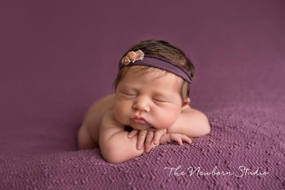 newborn baby girl purple studio