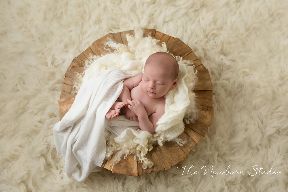 baby newborn in basket