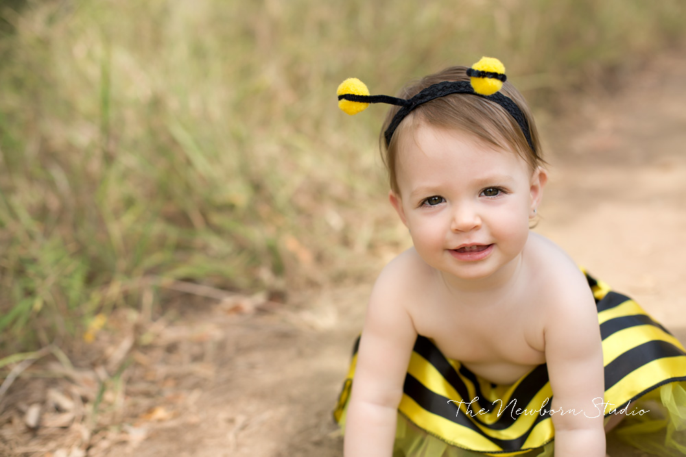 bee outfit baby girl outdoors