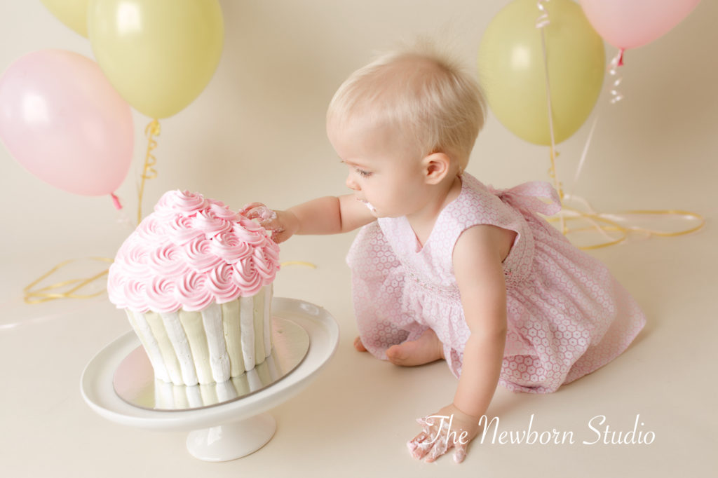 girl pink yellow cake smash