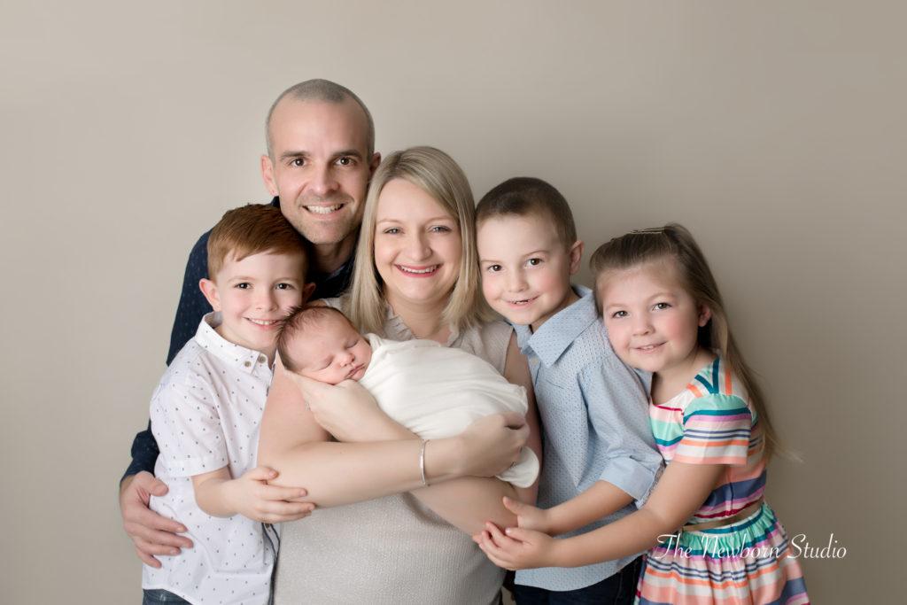 family and newborn studio photo